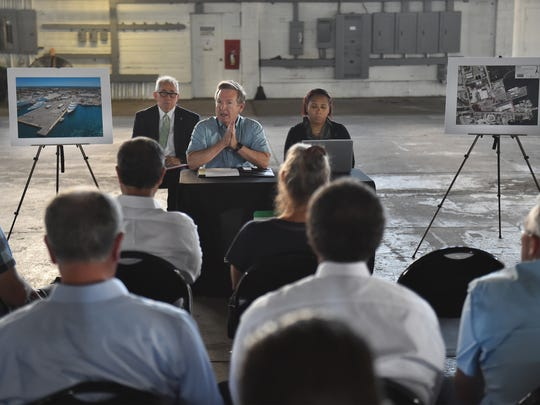 "Stan Payne (center), director of the Port of Fort Pierce; Ali Matos (right), Payne's assistant; and Peter Jones (left), planning and development services with St. Lucie County, meet with representatives of companies interested in development of the Port of Fort Pierce as a mega-yacht repair facility on Tuesday, May 8, 2018, from inside one of the port's warehouses in Fort Pierce. ""We've brought in some folks that are interested in perhaps submitting proposals for the development and operation of the port,"" Payne said. Following the meeting the representatives took a brief tour of the port property."