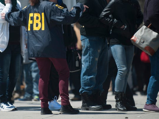 FBI agents search a methadone clinic located at 5th and Market streets in Camden on Wednesday, April 18, 2018.