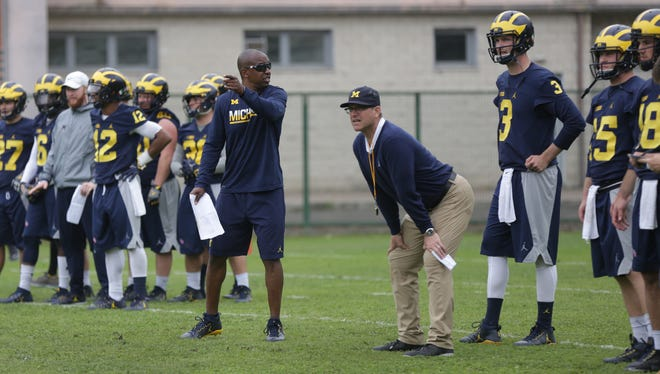 Michigan coach Jim Harbaugh, right and assistant coach Pep Hamilton during their first practice in Rome at Giulio Onesti Training Center on Thursday, April 27, 2017.