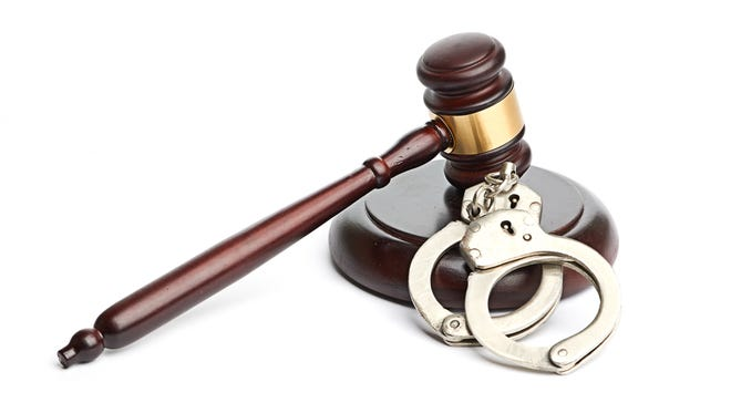 Getty Images/ iStockphoto handcuffs and gavel