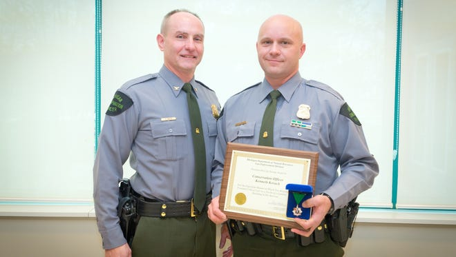 Conservation Officer Kenneth Kovach, right, received a Lifesaving Award. He is pictured with DNR Law Enforcement Division Chief Gary Hagler.