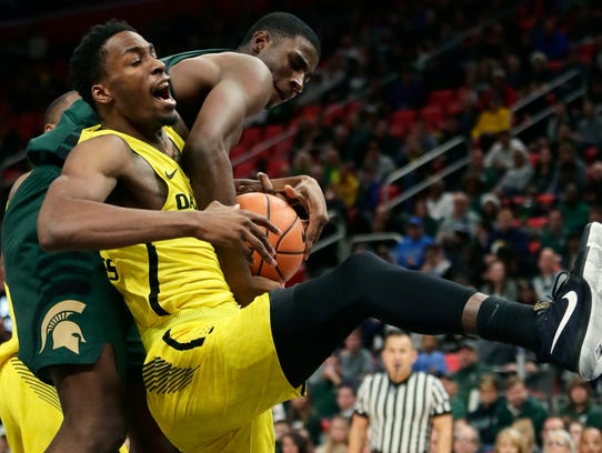Michigan State forward Jaren Jackson Jr. reaches over
