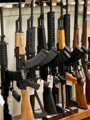 A rack displays various models of semi-automatic sporting rifles, Thursday, March 1, 2018.