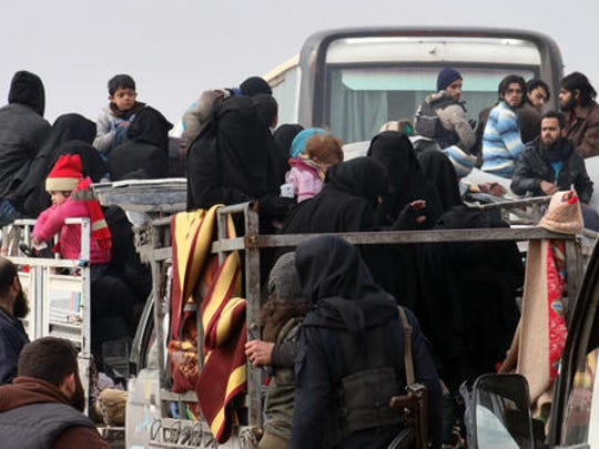This image released by Aleppo 24, shows residents of eastern Aleppo arriving in western rural Aleppo, Syria, Friday, Dec. 16, 2016, as part of an evacuation deal. The evacuation of eastern Aleppo stalled Friday after an eruption of gunfire, as the Syrian government and rebels threw accusations at each other, raising fears that a peaceful surrender of the opposition enclave could fall apart with thousands of people believed to be still inside.
