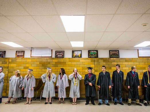 The graduates line up for a receiving line in the CWL