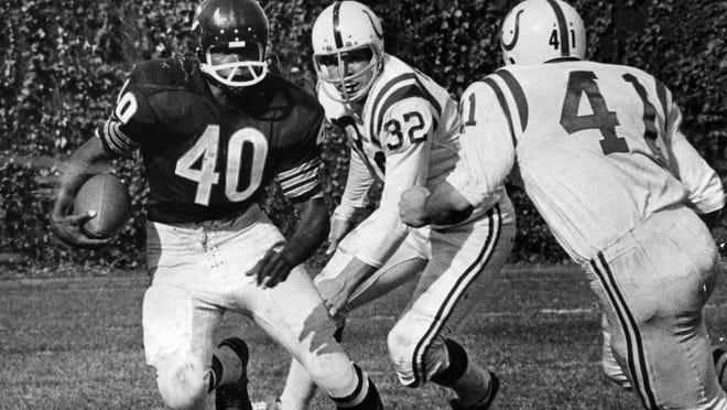Gale Sayers returns a punt against the Baltimore Colts on Oct. 9, 1966, in the Chicago Bears' home opener at Wrigley Field.