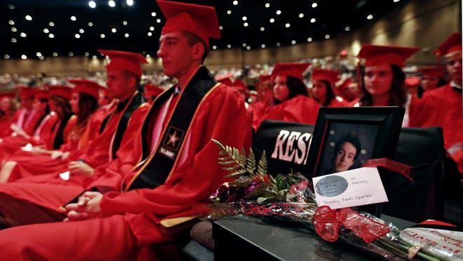 A seat was left open in memory of Timothy Ryan Sparks during Ozark High School's graduation ceremony held at James River Church in Ozark on May 15.