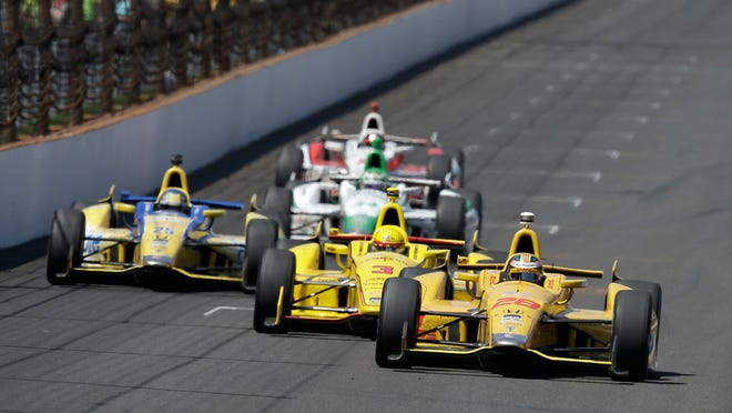 Ryan Hunter-Reay (28) takes the lead from Helio Castroneves, of Brazil, on the white flag lap during the Indianapolis 500 IndyCar auto race at Indianapolis Motor Speedway in Indianapolis, Sunday, May 25, 2014. Hunter-Reay went on to win the race. (AP Photo/Darron Cummings)