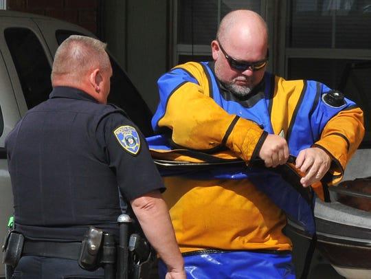 A member of the Wichita Falls Police Scuba Team removes