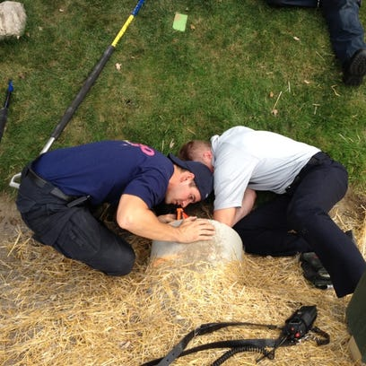 Inspector Dan Rickard (left) and Lt. Jason Baloga rescue