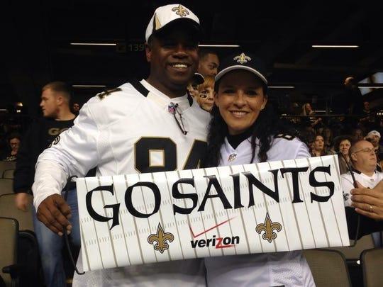 J. Rodney and Liz Pierre cheering on their favorite