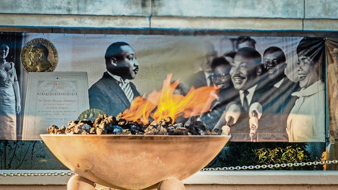 View of the Eternal Flame with Martin Luther King mural as a backdrop at the Martin Luther King National Historic Site. The site includes MLK's boyhood home, the MLK gravesite and the Ebenezer Baptist Church where MLK was a pastor.