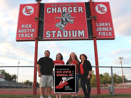 Proudly honoring the memory of Rick Austin by organizing a 5k run/walk in his honor last year were (from left) son Travis, daughter-in-law Becca, daughter Kaylin and wife Annette. The second annual race begins at 9:30 a.m. Saturday, Nov. 10 at Livonia Churchill H.S.