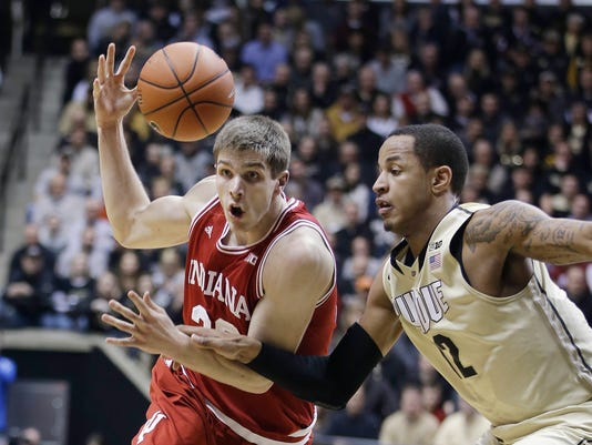 Indiana's Collin Hartman (30) drives as Purdue's Vince Edwards (12) defends during the first half of an NCAA collge basketball game Wednesday, Jan. 28, 2015, in West Lafayette, Ind. (AP Photo/Darron Cummings)
