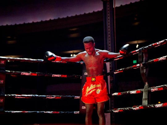 Dennis Munson Jr. stands in his corner during the second round of his first kickboxing match March 28, 2014. Munson collapsed after the fight and died later that night.