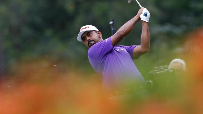 Anirban Lahiri follows his shot on the eighth hole Saturday during the third round of the CIMB Classic at Tournament Players Club  in Kuala Lumpur, Malaysia.