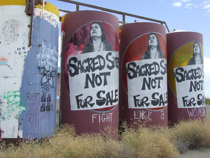 Artwork like this can been seen scattered along private properties off highway 89. These water vats sat in front of an abandoned motel site 47 miles south of the chapter house.