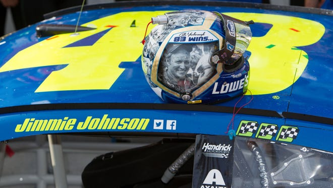 Jimmie Johnson tied Cale Yarborough for 83 career NASCAR Cup wins the same day he wore a helmet honoring his childhood hero.