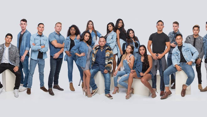 Josh Leon Geurrero, seated at center, poses with the talent from his agency, JRocket Model Management.