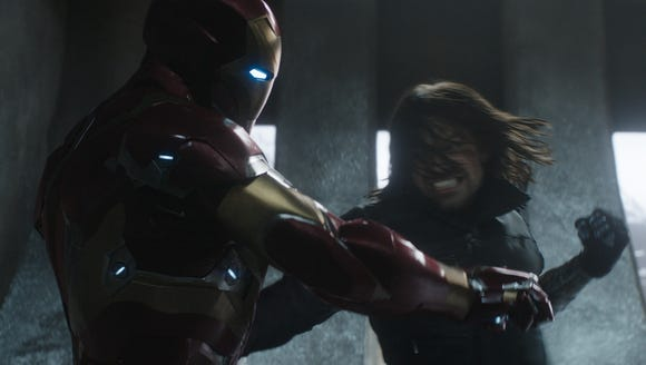 Iron Man (Robert Downey Jr.) battles the Winter Soldier