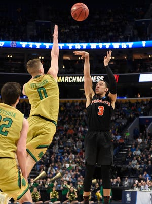 Princeton's Devin Cannady shoots over Notre Dame's  guard Rex Pflueger in the second half.