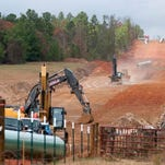 Crews work on construction of the TransCanada Keystone XL pipeline in Texas in 2012. The Obama administration is extending indefinitely the amount of time federal agencies have to review the Keystone XL pipeline, the State Department said Friday, likely punting the decision over the controversial oil pipeline past the midterm elections.