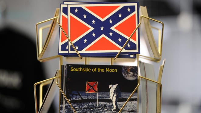 Postcards marked with the Confederate flag are still available in many southern states. The South Carolina legislature just passed a bill to remove the Confederate flag from the grounds of its statehouse.
