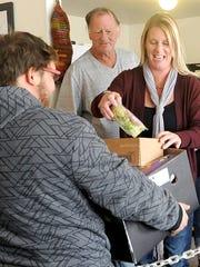 Pantry Director Shannon Juntunen fills a patron's box