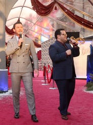 Luke Evans and Josh Gad perform at the world premiere