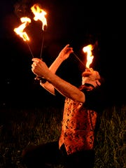A fire eater with Hellzapoppin Circus Sideshow