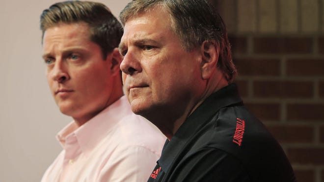 """Louisville athletic director Tom Jurich, right, talks as Mark Jurich, senior associate athletic director for development, listens at left. The University of Louisville plans to expand Papa John's Cardinal Stadium to 65,000 seats. About 10,000 seats will be added with the expansion, including 1,000 club seats and 65 """"premium"""" loge level seats as well as 10 field level suites. The design will connect the east and west sides of the stadium. Athletic Director Tom Jurich says he plans to have the expansion completed in the next two years, though no completion date has been set. The project cost is an estimated $55 million, raised through sponsorships, private donations and ticket sales. Aug. 27, 2015"""