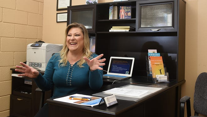 Rhonda Davis talks about her hypnotherapy on Tuesday at her office in Farmington. Davis says hypnotherapy can help patients with everything from losing weight to managing stress.