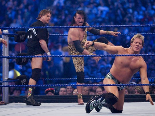 """Jimmy """"Superfly"""" Snuka, center, steps into the ring"""
