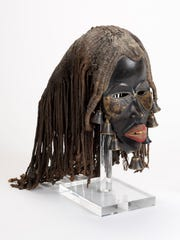 This undated mask from West Africa's Guinea Coast is made of painted wood, metal and a woven material coated in mud or clay. It's part of the Des Moines Art Center's permanent collection.