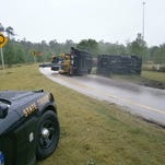 The exit ramp to Old St. Augustine Road will be closed for two hours after a dump truck pulling a trailer overturned Friday afternoon.