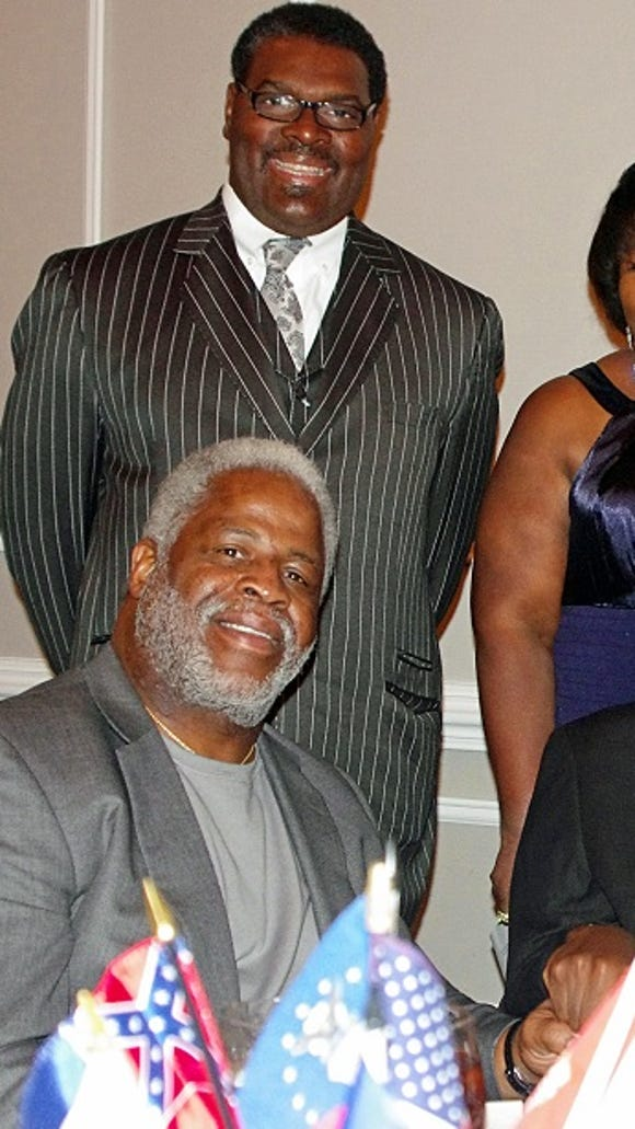 Earl Campbell, bottom left, meets with Charles Scott Jr., bottom right, and his father Charles Sr. and mother Ida.