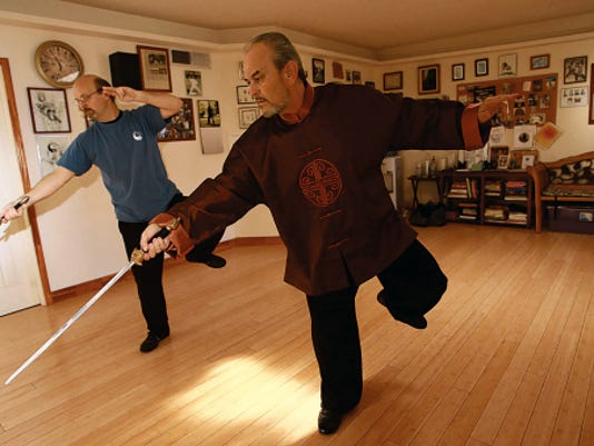 El Paso tai chi instructors Wolf Carter, left, and Ray Abeyta, go through movements last week.