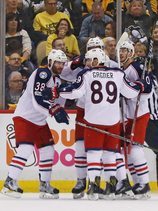 Columbus Blue Jackets' Boone Jenner (38) celebrates his goal with teammates during the second period in Game 5 of an NHL first-round hockey playoff series against the Pittsburgh Penguins in Pittsburgh, Thursday, April 20, 2017. (AP Photo/Gene J. Puskar)