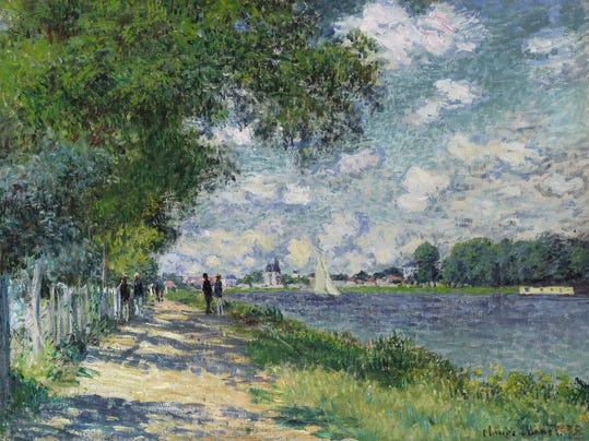 """This undated photo provided by Sotheby's auction house shows the painting entitled """"La Seine a Argenteuil"""" by artist Claude Monet. The 1875 painting is one of two Monet's from the collection of the late Buffalo Bills owner Ralph Wilson that will go up on the block at Sotheby's in London on Monday, June 23, 2014. (AP Photo/Sotheby's)"""