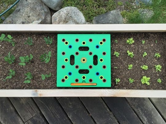 Is it a weed or a seedling? If you sow seeds through the holes of the Seeding Square, you'll know what's where.
