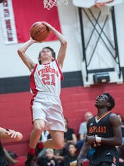 Fannett-Metal's Mikel McGee (21) aided the Tigers in a trip to the championship game of the Fannett-Metal Christmas tournament. F-M takes on Forbes Road in a SHL/ICC clash on Wednesday.