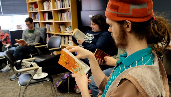 "Ansel Courant, an MSU 2014 graduate, reads aloud ""The Catcher in the Rye"" along with others in the James Madison College Library Saturday, April 2, 2016. The group plans to finish the book in one sitting in about nine to ten hours."
