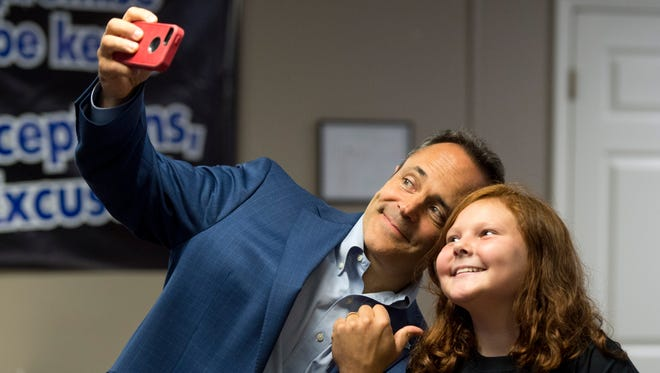 Kentucky Governor Matt Bevin takes a selfie with Allison Alexander, 11, at the Audubon Kids Zone in Henderson, Ky., on Thursday, Oct. 12, 2017. Gov. Bevin spoke with many of the participants in the Audubon Kids Zone about their various projects in the organization such as photography.