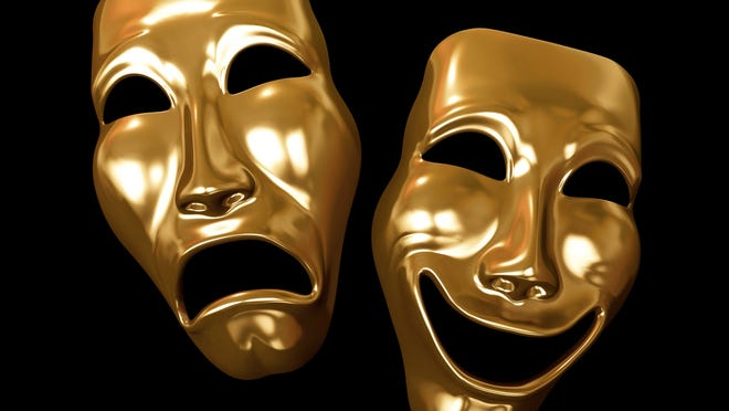 Golden comedy and tragedy masks on a black background.
