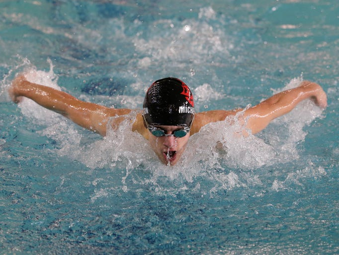 Lincoln's Nick Michaelson swims the 100 yard butterfly