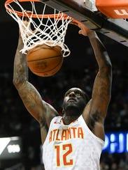 Atlanta Hawks forward Taurean Prince dunks against the Philadelphia 76ers during the first half of an NBA basketball game Friday, March 30, 2018, in Atlanta. (AP Photo/John Amis)