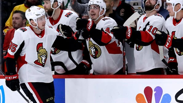 Ottawa Senators center Matt Duchene, left, celebrates with teammates after scoring his goal against the Chicago Blackhawks during the second period of an NHL hockey game Wednesday, Feb. 21, 2018, in Chicago. (AP Photo/Nam Y. Huh)