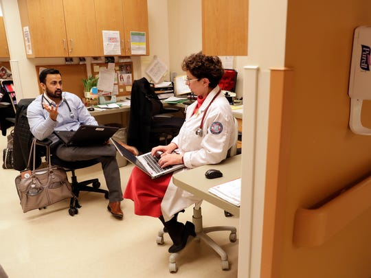 Dr. Waqas Yasin, talks with Dr. Lynn Budzak after examining a patient Feb. 22, 2018 at the Milo C. Huempfner VA Health Care Center in Green Bay, Wis. Yasin, originally from Pakistan, is one of four residents participating in the new Northeastern Wisconsin Psychiatry Program, which includes general medical and mental health training. Sarah Kloepping/USA TODAY NETWORK-Wisconsin
