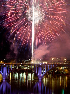 Fireworks explode over the Tennessee River during the Fourth of July celebration in Knoxville on July 4, 2015.