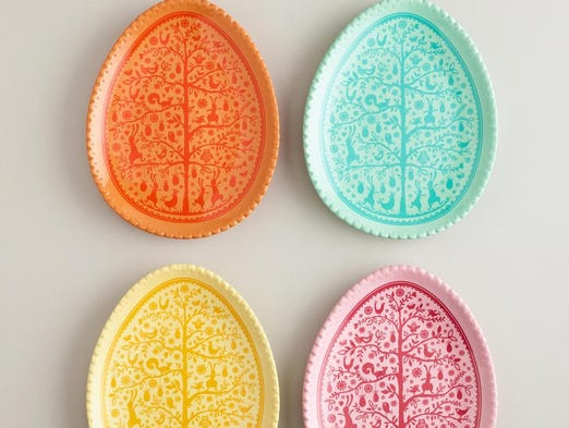 Brighten up your holiday dinner table. Easter egg plates, $27.96 for a set of four at Cost Plus World Market.  (Gannett/File)